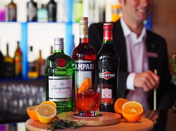 Bottles with orange cocktail